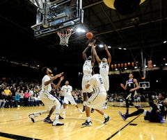 Feb 13, 2016; Boulder, CO, USA; Colorado Buffaloes forward Wesley Gordon (1) and guard George King (24) jump for a rebound against the Washington Huskies in the second half at the Coors Events Center. The Buffaloes defeated the Huskies 81-80. Mandatory Credit: Ron Chenoy-USA TODAY Sports
