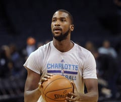 Injured Charlotte Hornets forward Michael Kidd-Gilchrist (14) warms up before the game against the Boston Celtics at Time Warner Cable Arena.