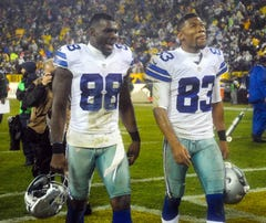 Dec 13, 2015; Green Bay, WI, USA;  Dallas Cowboys wide receiver Dez Bryant (88) and wide receiver Terrance Williams (83) walk off the field