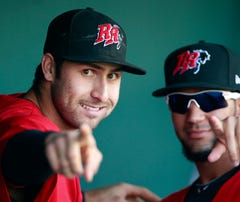 Frisco Rough Riders third baseman Joey Gallo (24) and right fielder Nomar Mazara (9) in the dugout before the game