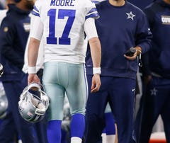 Dallas Cowboys quarterback Tony Romo greets quarterback Kellen Moore (17)