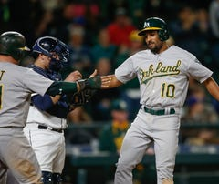 SEATTLE, WA - OCTOBER 03:  Marcus Semien #10 of the Oakland Athletics is congratulated by Stephen Vogt #21 after hitting a two-run home run against the Seattle Mariners in the thirteenth inning at Safeco Field on October 3, 2015 in Seattle, Washington.  (Photo by Otto Greule Jr/Getty Images) *** Local Caption *** Stephen Vogt;Marcus Semien
