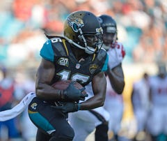 Aug 28, 2014; Jacksonville, FL, USA; Jacksonville Jaguars wide receiver Denard Robinson (16) carries the ball against the Atlanta Falcons at EverBank Field. Mandatory Credit: Richard Dole-USA TODAY Sports