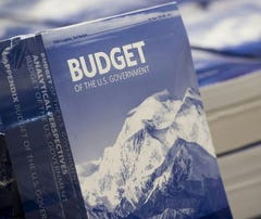 Copies of President Obama's Fiscal Year 2017 budget are distributed by the Senate Budget Committee distributes on Capitol Hill Tuesday.