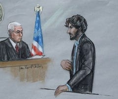 n this courtroom sketch, Boston Marathon bomber Dzhokhar Tsarnaev, right, stands before U.S. District Judge George O'Toole Jr. as he addresses the court during his sentencing, Wednesday, June 24, 2015, in federal court in Boston.
