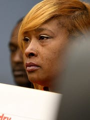 Tears stream down the face of Melanie Davison on Wednesday