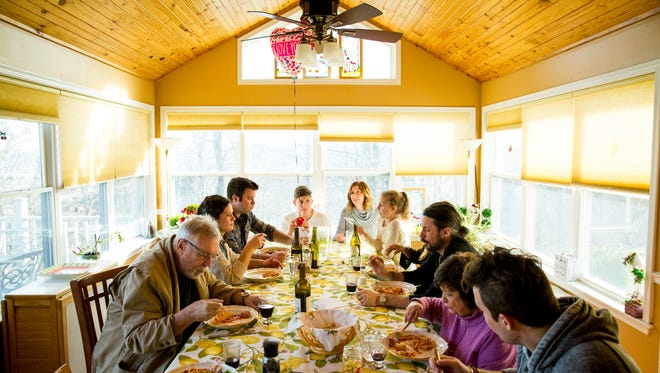 The Bonavita/Frommeyer family eat dinner together in Crescent Springs, Ky. Sunday, February 26, 2017. The family comes together every Sunday for a multi course meal. They are descendants of immigrants from Fuscaldo, Italy. There are so many Fuscaldese in Cincinnati that they have created their own society. They come together for picnics and parties.