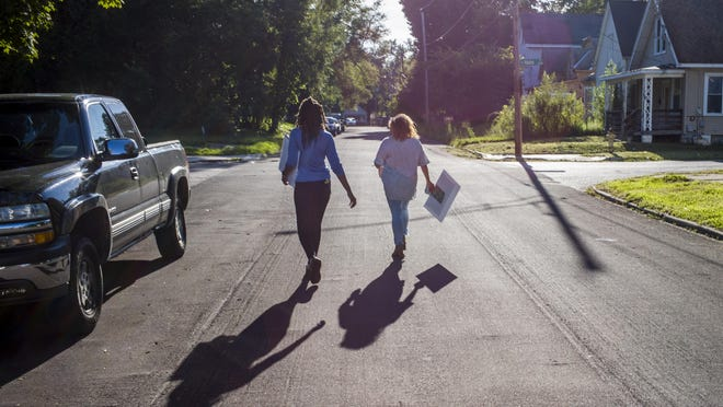 Tahari Allen, left, and Angela Kramer walk on Seibold Street in Peoria's South Side during a walk of the neighborhood by members of Peoria Community Against Violence Thursday, July 23, 2020. Allen is also a representative of OSF Strive Trauma Recovery Program.