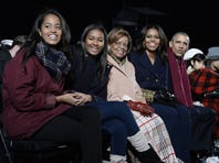 WASHINGTON, DC - DECEMBER 02:  Malia Obama, Sasha Obama, mother-in-law Marian Robinson, first lady Michelle Obama and President Barack Obama attend the national Christmas tree lighting ceremony on the Ellipse south of the White House December 3, 2015 in Washington, DC. The lighting of the tree is an annual tradition attended by the president and the first family. (Photo by Olivier Douliery- Pool/Getty Images)