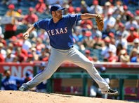 September 6, 2015; Anaheim, CA, USA; Texas Rangers starting pitcher Colby Lewis (48) pitches the second inning against the Los Angeles Angels at Angel Stadium of Anaheim. Mandatory Credit: Gary A. Vasquez-USA TODAY Sports