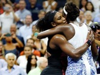 Serena Williams, left, hugs Venus Williams after winning their quarterfinal match at the U.S. Open tennis tournament, Sept. 8, 2015, in New York.