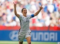 Jul 5, 2015; Vancouver, British Columbia, CAN; United States midfielder Carli Lloyd (10) celebrates after scoring her third goal against Japan during the final of the 2015 Women's World Cup at BC Place Stadium. The U.S won 5-2. Mandatory Credit: Michael Chow-USA TODAY Sports
