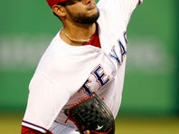 Oct 2, 2015; Arlington, TX, USA; Texas Rangers starting pitcher Martin Perez (33) throws a pitch in the first inning against the Los Angeles Angels at Globe Life Park in Arlington. Mandatory Credit: Tim Heitman-USA TODAY Sports
