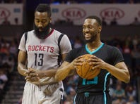 Mar 12, 2016; Charlotte, NC, USA; Charlotte Hornets guard Kemba Walker (15) smiles after drawing the foul call against Houston Rockets guard James Harden (13) in the first half at Time Warner Cable Arena. Mandatory Credit: Jeremy Brevard-USA TODAY Sports