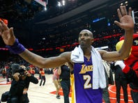 Kobe Bryant #24 of the Los Angeles Lakers waves to the fans after their 100-87 loss to the Atlanta Hawks at Philips Arena on December 4, 2015 in Atlanta, Georgia.  NOTE TO USER User expressly acknowledges and agrees that, by downloading and or using this photograph, user is consenting to the terms and conditions of the Getty Images License Agreement.  (Photo by Kevin C. Cox/Getty Images)