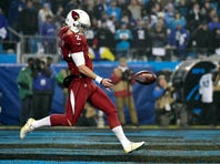 Jan 3, 2015; Charlotte, NC, USA; Arizona Cardinals punter Drew Butler (2) punt the ball during the third quarter against the Carolina Panthers in the 2014 NFC Wild Card playoff football game at Bank of America Stadium.
