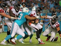 Matt Ryan #2 of the Atlanta Falcons is sacked by Cameron Wake #91 and Ndamukong Suh #93 of the Miami Dolphins during a preseason game at Sun Life Stadium on August 29, 2015 in Miami Gardens, Florida.