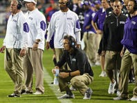 Oct 29, 2015; Fort Worth, TX, USA; TCU Horned Frogs offensive coordinator Sonny Cumbie (black shirt) during a game against the West Virginia Mountaineers at Amon G. Carter Stadium. TCU won 40-10.