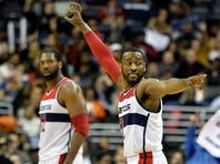 Jan 20, 2016; Washington, DC, USA; Washington Wizards guard John Wall (2) reacts to a shot by guard Bradley Beal (not pictured) during the second half against the Miami Heat at Verizon Center. Washington Wizards defeated Miami Heat 106-87. Mandatory Credit: Tommy Gilligan-USA TODAY Sports