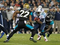 Dec 18, 2014; Jacksonville, FL, USA;Jacksonville Jaguars outside linebacker Telvin Smith (50) and cornerback Aaron Colvin (22) tackle Tennessee Titans wide receiver Kendall Wright (13)  during the second quarter at EverBank Field. Mandatory Credit: Kim Klement-USA TODAY Sports