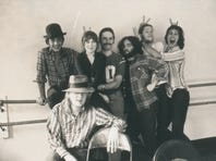 John Belushi and Chevy Chase goofing off with other members of the National Lampoon troop.