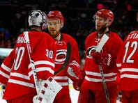 Dec 5, 2015; Raleigh, NC, USA;  Carolina Hurricanes goalie Cam Ward (30) is congratulated by teammate forward Brad Malone (24) after the game against the Montreal Canadiens at PNC Arena. The Carolina Hurricanes defeated the Montreal Canadiens 3-2.