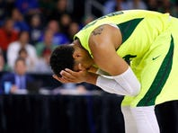 Mar 17, 2016; Providence, RI, USA; Baylor Bears guard Ishmail Wainright (24) covers his face after taking an elbow during the second half of a first round game against Yale during the 2016 NCAA Tournament at Dunkin Donuts Center. Mandatory Credit: Winslow Townson-USA TODAY Sports