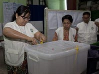 Myanmar election commission officer opens the ballot box to start the vote counting at a polling station during the country's general election Sunday, Nov. 8, 2015, in Yangon, Myanmar. Myanmar voted Sunday in historic elections that will test whether popular mandate can loosen the military's longstanding grip on power, even if opposition leader Aung San Suu Kyi's party secures a widely-expected victory.