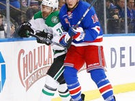 New York Rangers center J.T. Miller (10) and Dallas Stars center Vernon Fiddler (38) battle for position along the boards during the third period at Madison Square Garden.