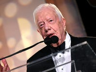 """In this July 7, 2015 file photo, former US President Jimmy Carter signs his new Book """"A Full Life: Reflections at Ninety"""" at Barnes & Noble on 5th avenue in New York.  Doctors treating Jimmy Carter believe the 91-year-old former president is responding well to cancer treatment and there is no evidence of a new growth, aides said November 10, 2015. In a statement, the Carter Center said the 39th president """"has received good news"""" from doctors who removed a tumor from his liver only to find four melanoma spots on his brain."""