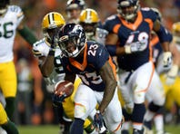 Nov 1, 2015; Denver, CO, USA; Denver Broncos running back Ronnie Hillman (23) carries for a touchdown in the second quarter against the Green Bay Packers at Sports Authority Field at Mile High.