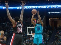 Nov 15, 2015; Charlotte, NC, USA; Charlotte Hornets guard Kemba Walker (15) shoots the ball over Portland Trail Blazers forward Cliff Alexander (34) during the second half at Time Warner Cable Arena. Hornets defeated Portland 106-94. Mandatory Credit: Jeremy Brevard-USA TODAY Sports