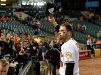 Oct 4, 2015; Baltimore, MD, USA; Baltimore Orioles first baseman Chris Davis (19) waves to the fans as he walks off the field after the game against the New York Yankees at Oriole Park at Camden Yards. The Orioles won 9-4. Mandatory Credit: Tommy Gilligan-USA TODAY Sports