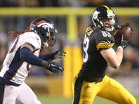 Dec 20, 2015; Pittsburgh, PA, USA; Pittsburgh Steelers tight end Heath Miller (83) runs after a catch against Denver Broncos strong safety David Bruton (30) during the second quarter at Heinz Field.