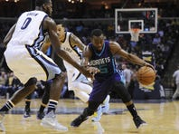 Charlotte Hornets guard Kemba Walker (15) dribbles the ball around Memphis Grizzlies forward JaMychal Green (0) during the second half at FedExForum. The Hornets won 123-99.