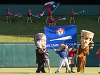 The Texas Rangers mascots celebrate the Rangers' win over the Los Angeles Angels