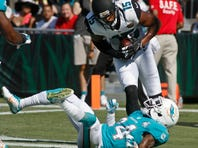 Sep 20, 2015; Jacksonville, FL, USA; Jacksonville Jaguars wide receiver Allen Robinson (15) catches a touchdown pass as Miami Dolphins cornerback Brice McCain (24) cannot defend in the first quarter at EverBank Field. Mandatory Credit: Phil Sears-USA TODAY Sports