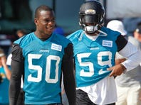 Jul 31, 2015; Jacksonville, FL, USA; Jacksonville Jaguars outside linebacker Telvin Smith (50) and defensive end Ryan Davis (59) take the field during training camp workouts at Florida Blue Health & Wellness Practice Field. Mandatory Credit: Reinhold Matay-USA TODAY Sports