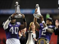 Dec 31, 2014; Atlanta , GA, USA; TCU Horned Frogs defensive end James McFarland (40) and quarterback Trevone Boykin (2) hold up their trophies after the 2014 Peach Bowl against the Mississippi Rebels at the Georgia Dome. TCU defeated Ole Miss 42-3.