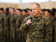 Lt. Gen. Robert Neller, commander of Marine Forces Command and Marine Corps Forces Europe, talks with troops of Black Sea Rotational Force during his visit to Mihail Kogalniceanu Air Base in Romania.