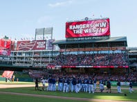 The Texas Rangers celebrate their win over the Los Angeles Angels at Globe Life Park in Arlington.