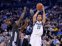 Apr 11, 2015; Oakland, CA, USA; Minnesota Timberwolves guard Kevin Martin (23) attempts a shot over Golden State Warriors forward Draymond Green (23) in the first quarter at Oracle Arena. Mandatory Credit: Cary Edmondson-USA TODAY Sports