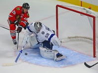 Chicago Blackhawks center Jonathan Toews (19) scores the winning goal against Tampa Bay Lightning goalie Kristers Gudlevskis (50) during the overtime period at the United Center. Chicago won 1-0 in OT.