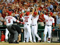 Aug 25, 2015; Washington, DC, USA; Washington Nationals first baseman Ryan Zimmerman (11) is congratulated by third baseman Yunel Escobar (5) and second baseman Anthony Rendon (6) and shortstop Ian Desmond (20) after hitting a grand slam against the San Diego Padres during the sixth inning at Nationals Park. Mandatory Credit: Brad Mills-USA TODAY Sports