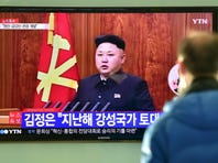 """A South Korean man watches a television screen showing North Korean leader Kim Jong-Un's New Year speech, at a railroad station in Seoul on January 1, 2015. North Korean leader Kim Jong-Un said he was open to the """"highest-level"""" talks with South Korea as he called for an improvement in strained cross-border relations."""