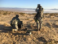 2nd Lt. Ian Reynoso, a student in the Army's first Cyber Basic Officer Leader Course at the Army Cyber School, uses a field computer to probe for a targeted wireless network signal during a field training exercise at Fort Gordon, Ga., March 1, 2016.