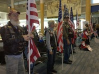 Volunteers with Operation Handshake are welcoming home returning military members and thanking them for their service (Nov. 25, 2015).