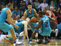 Teammates Cody Zeller #40 and Marvin Williams #2 of the Charlotte Hornets go after a loose ball against Al Horford #15 of the Atlanta Hawks during their game at Time Warner Cable Arena on November 1, 2015 in Charlotte, North Carolina.