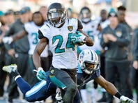 Dec 6, 2015; Nashville, TN, USA; Jacksonville Jaguars running back T.J. Yeldon (24) rushes against Tennessee Titans inside linebacker Avery Williamson (54) during the second half at Nissan Stadium. Tennessee won 42-39. Mandatory Credit: Jim Brown-USA TODAY Sports