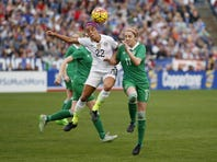 SAN DIEGO, CA - JANUARY 23:  Mallory Pugh #22 of the United States fights for the ball with Julie Ann Russell #11 of Ireland as the United States won 5-0 at Qualcomm Stadium on January 23, 2016 in San Diego, California.  (Photo by Todd Warshaw/Getty Images)